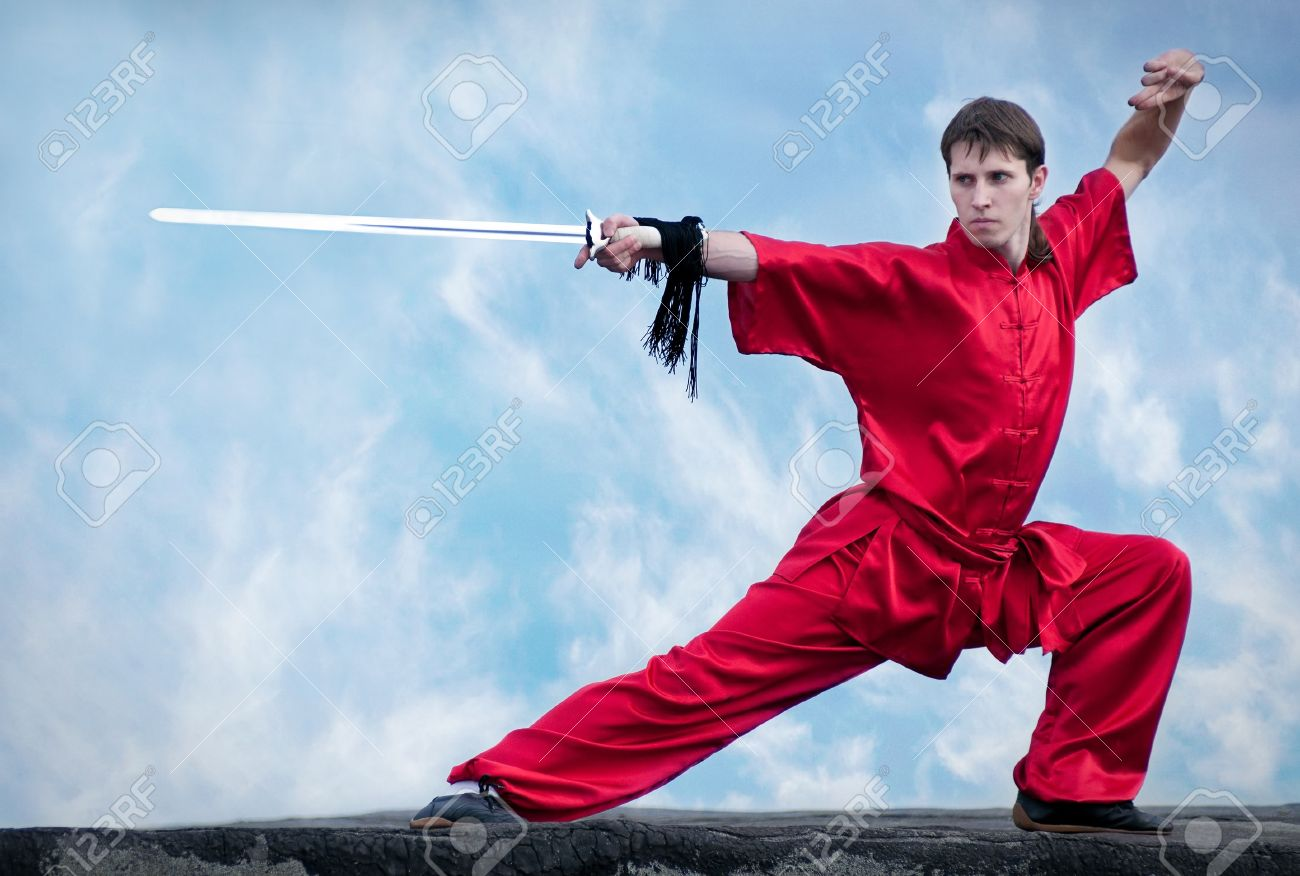 Shaolin warriors wushoo man in red with sword practice martial