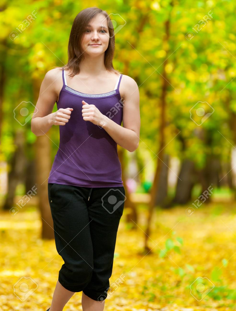 Young woman running outdoors on a lovely sunny winter (fall) day Stock Photo - 12872352