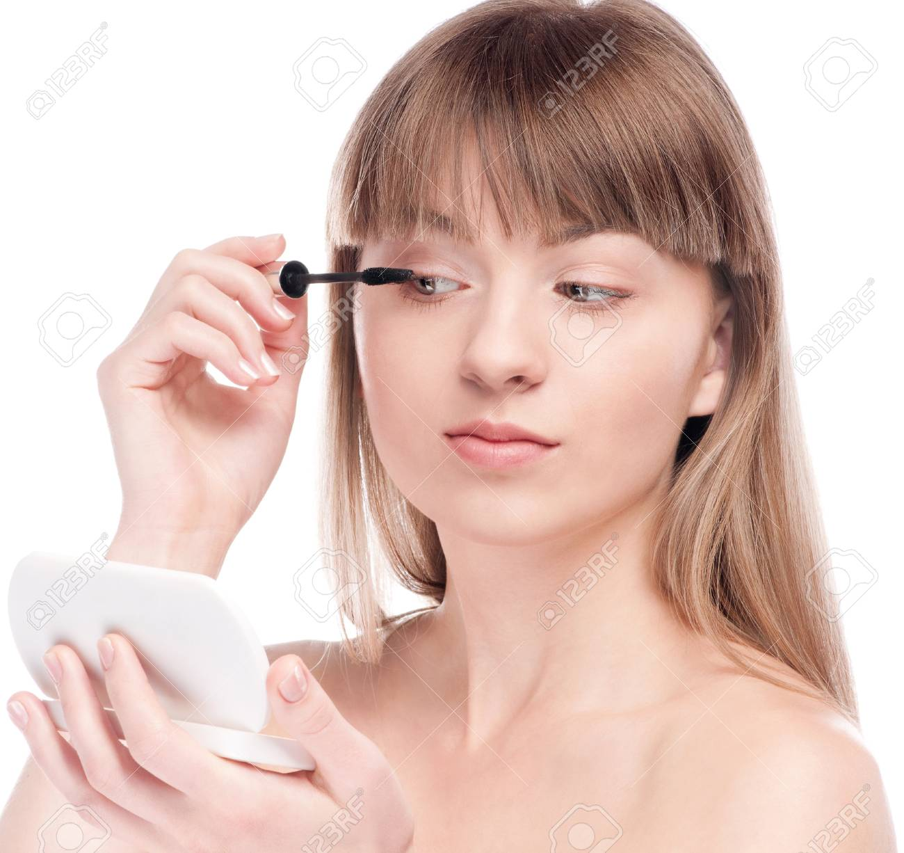 Close-up portrait of young beautiful woman with brush for make-up. Mascara, eye zone Stock Photo - 13318857