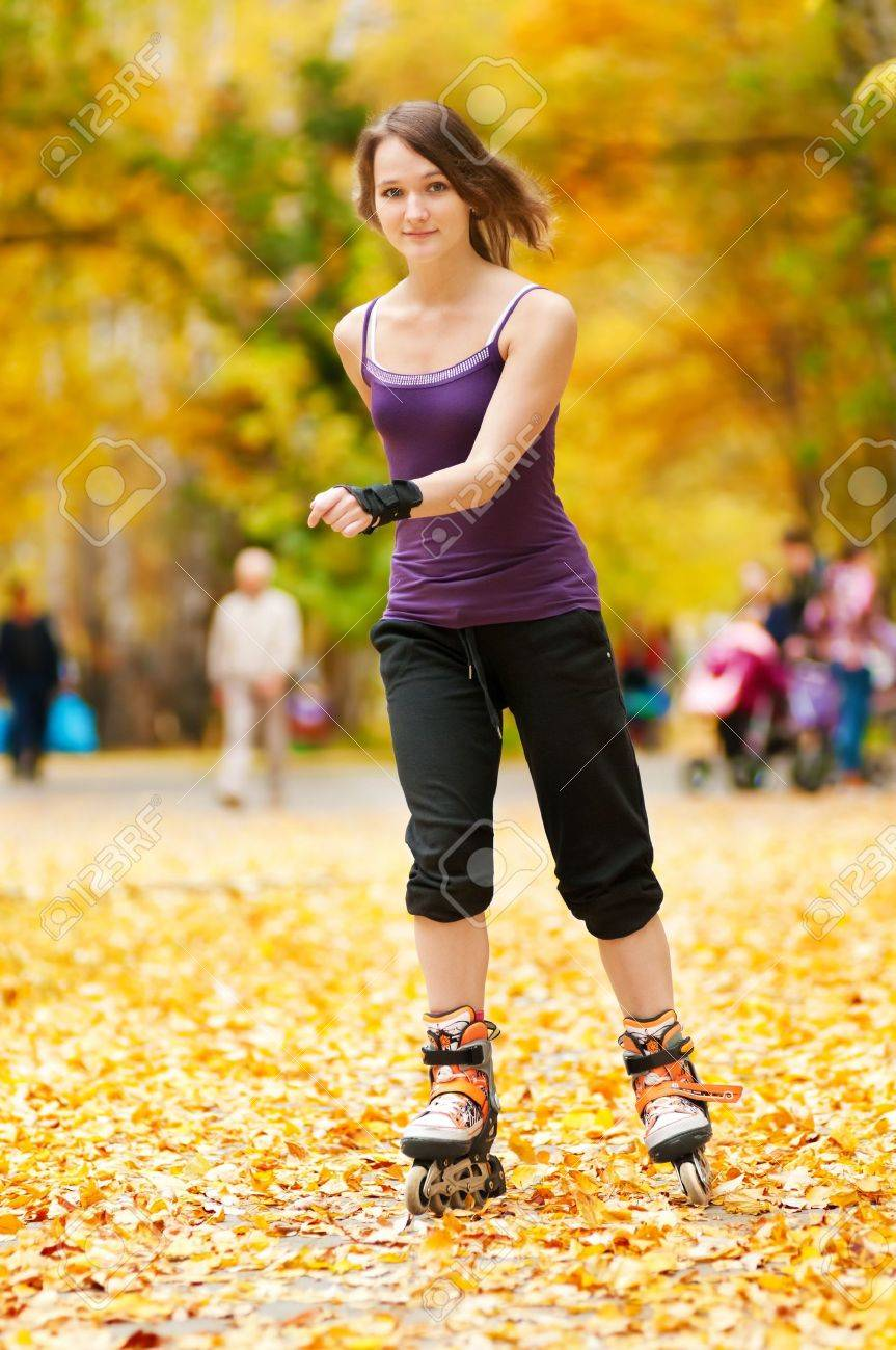 happy young woman on roller skates in the autumn park Stock Photo - 13621897