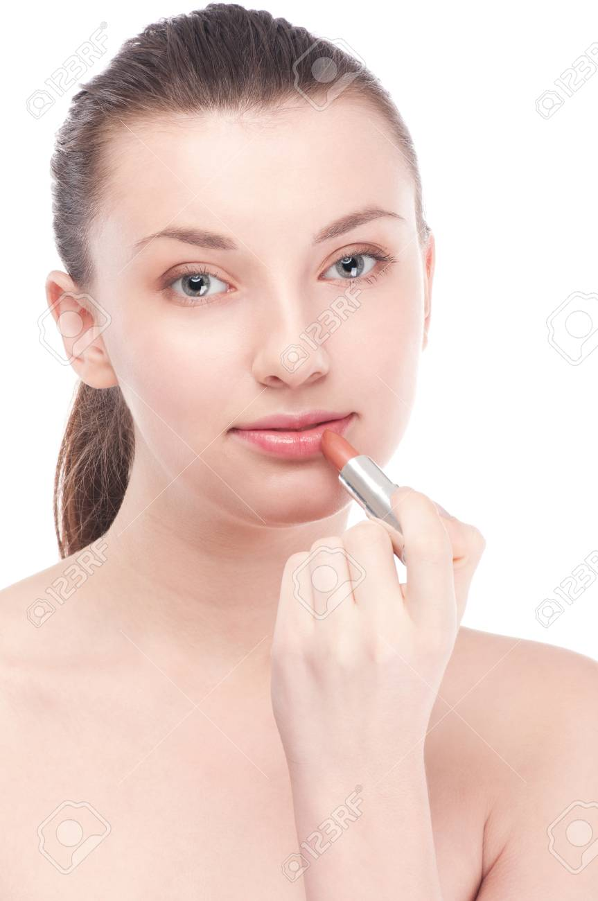 Close-up portrait of young beautiful woman with lipstick brush for make-up. Lips zone Stock Photo - 15262740