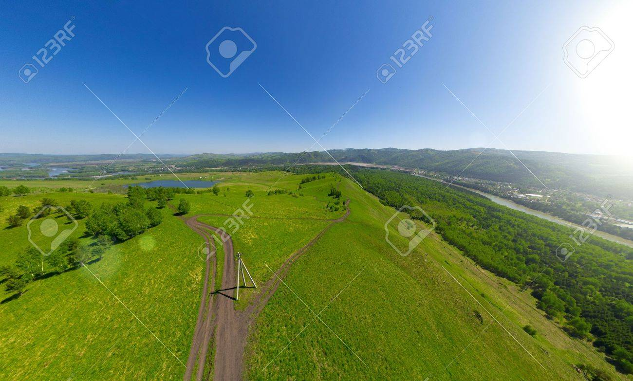 Beautiful small green mountain road from above  aerial view Stock Photo - 15752467