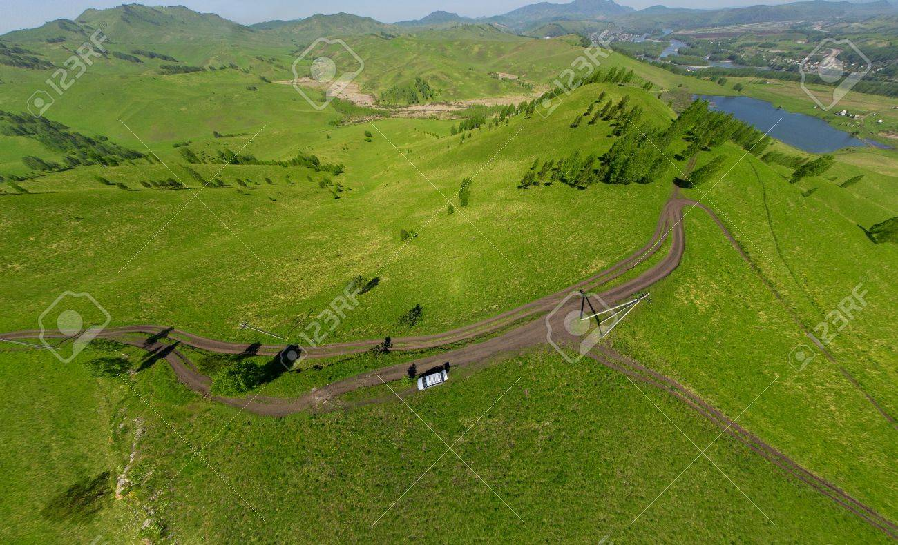 Beautiful small green mountain road from above  aerial view Stock Photo - 15752487