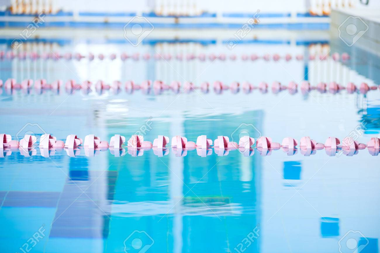 Interior Of Public Indoor Swimming Pool Witch Racing Lanes And Blue Water  Stock Photo   28644987