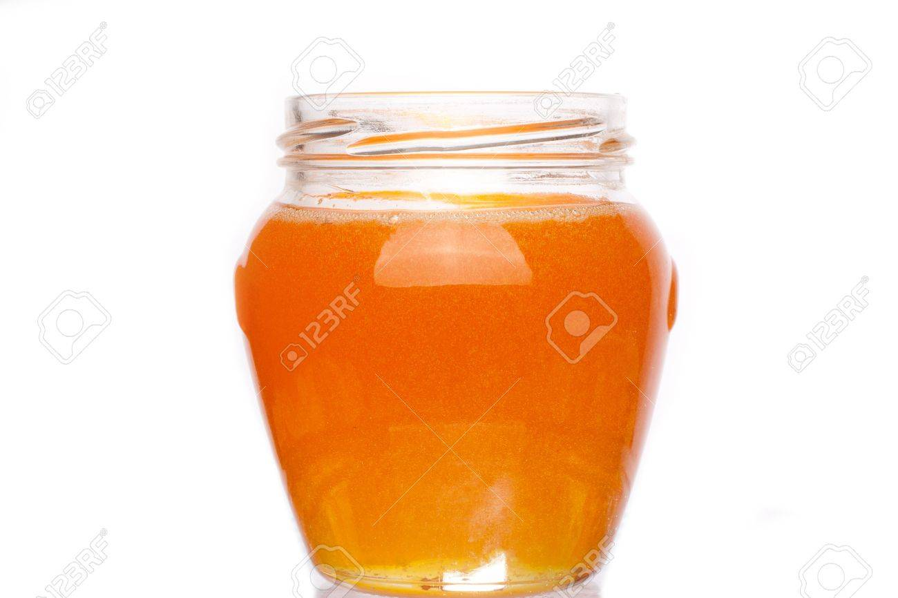 Real honey in a jar isolated on white Stock Photo - 11396771