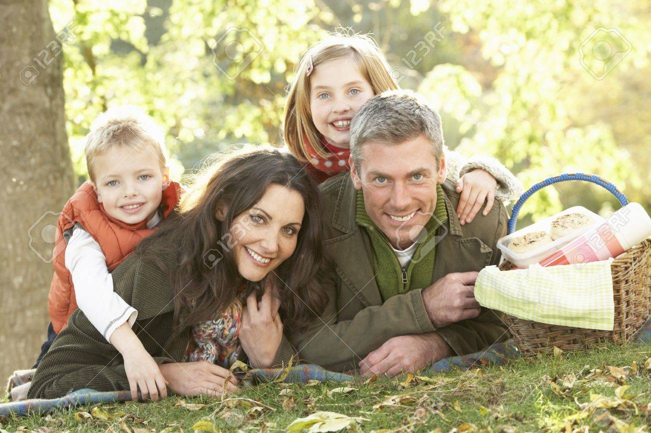 Family Group Relaxing Outdoors In Autumn Landscape Stock Photo - 7185228