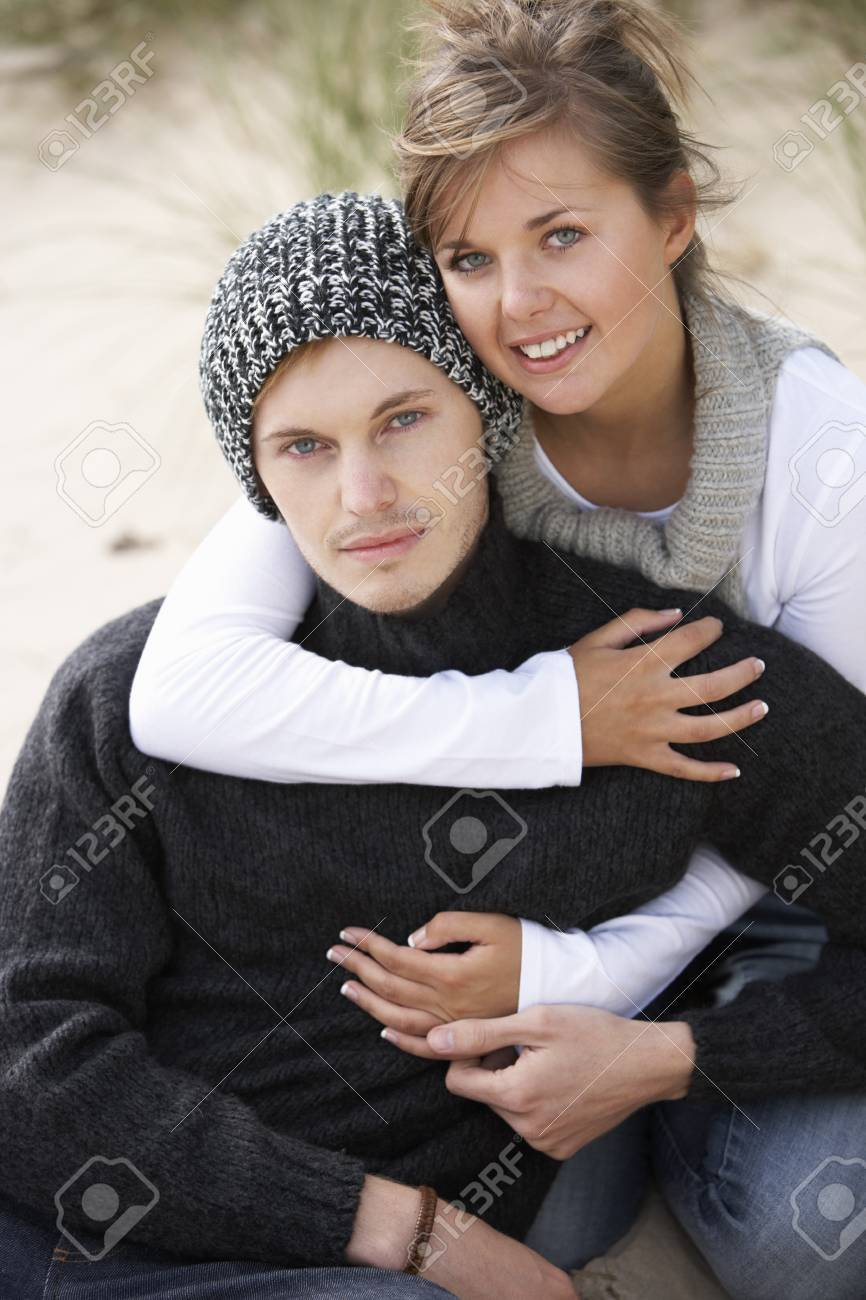 Young Romantic Couple Relaxing On Beach Together Stock Photo - 7182071