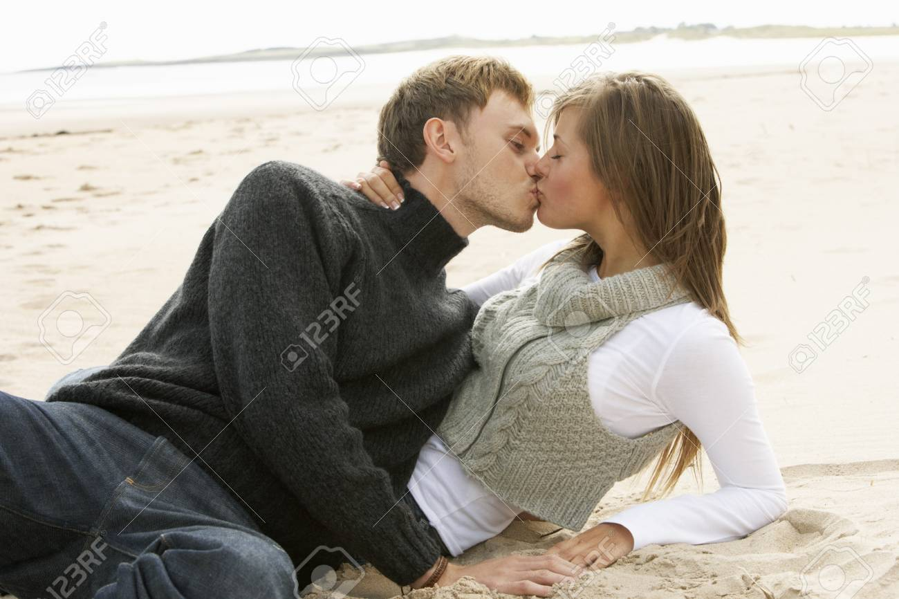 Portrait Of Romantic Young Couple Kissing On Beach Stock Photo - 7182347