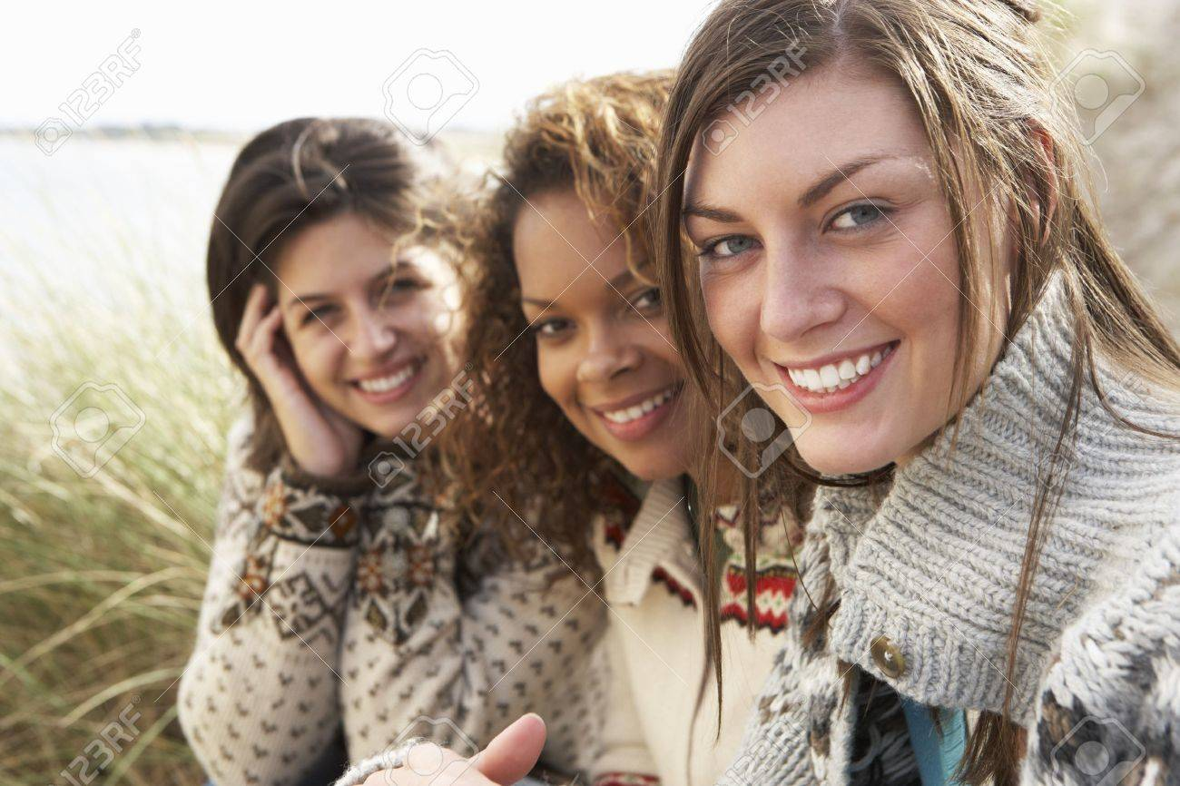 Three Young Girls Sitting In Sand Dunes Together Stock Photo - 7175595