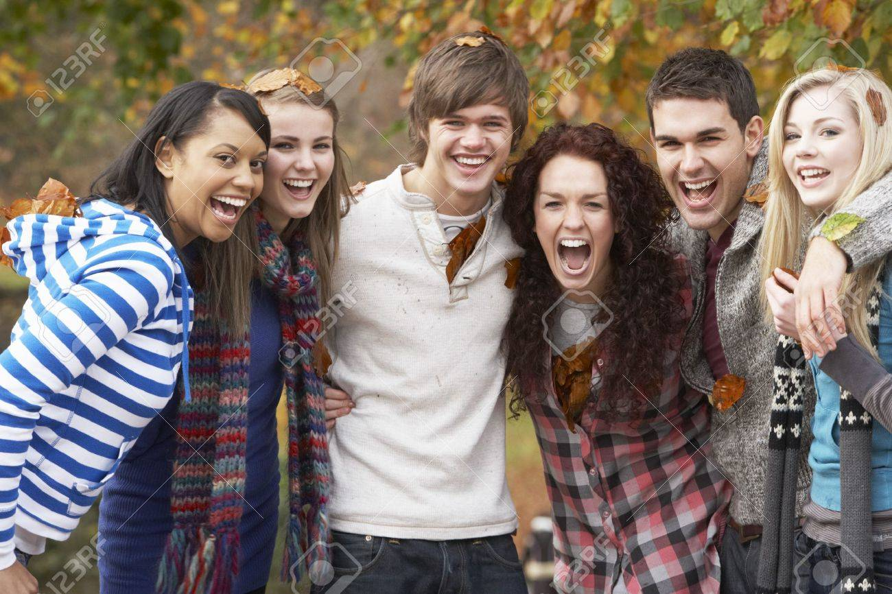 Group Of Six Teenage Friends Having Fun In Autumn Park Stock Photo - 7175791