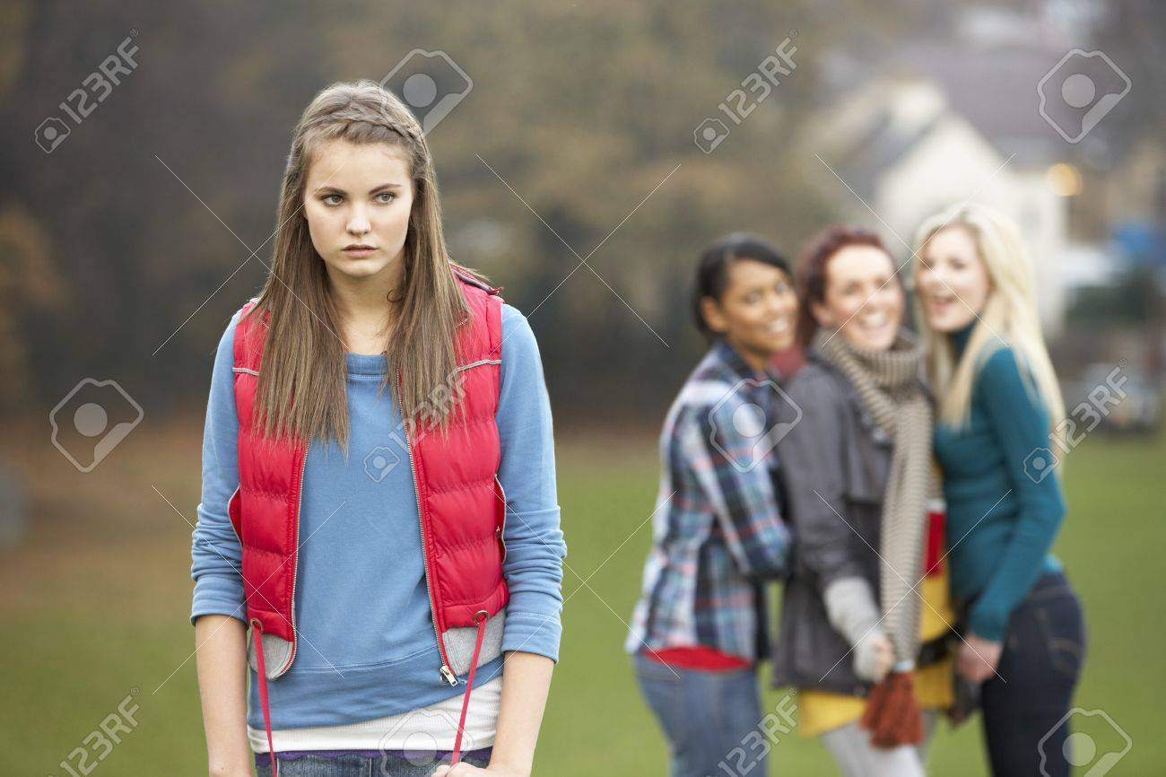 Upset Teenage Girl With Friends Gossiping In Background Stock Photo - 7178072