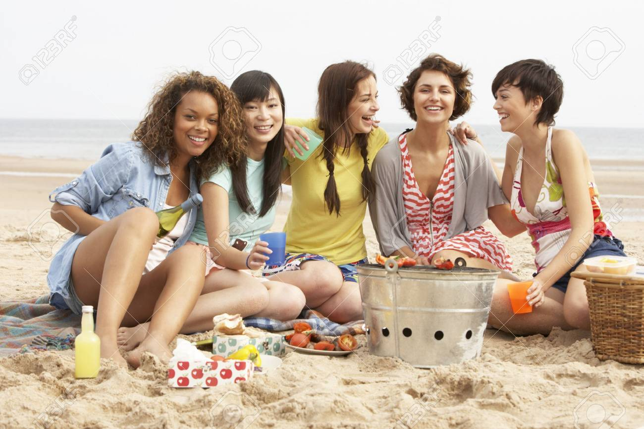 Group Of Girls Enjoying Barbeque On Beach Together Stock Photo - 8452714