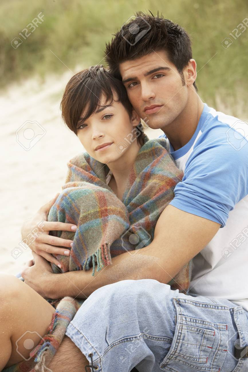 Romantic Young Couple Embracing On Beach Stock Photo - 8452527