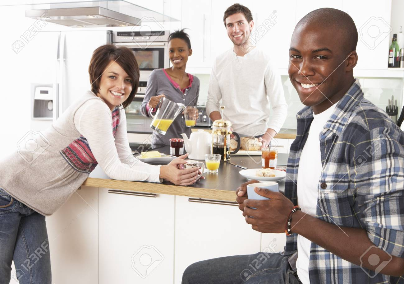 Group Of Young Friends Preparing Breakfast In Modern Kitchen Stock Photo - 8452735