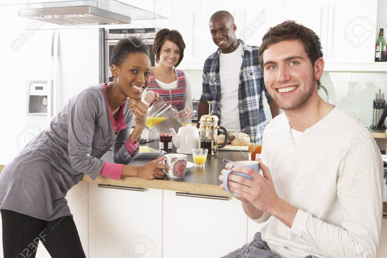 Group Of Young Friends Preparing Breakfast In Modern Kitchen Stock Photo - 8453025