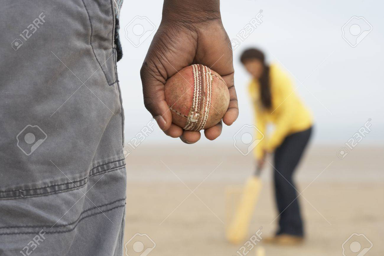 Young Couple Playing Cricket On Autumn Beach Holiday Stock Photo - 10198698