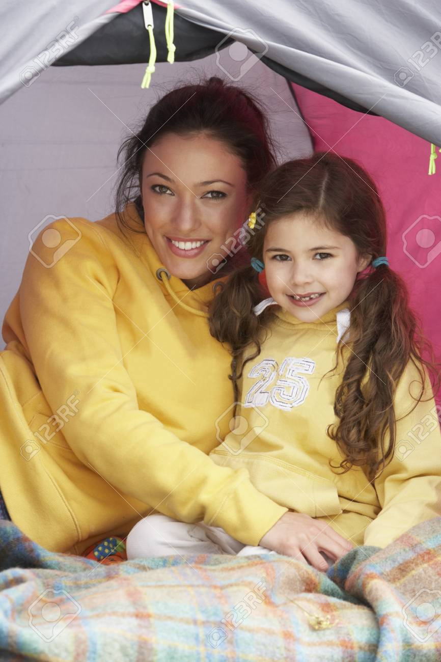 Mother And Daughter Relaxing Inside Tent On Camping Holiday Stock Photo - 10198921