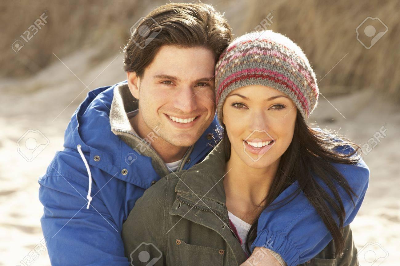 Romantic Young Couple On Winter Beach Stock Photo - 10198955