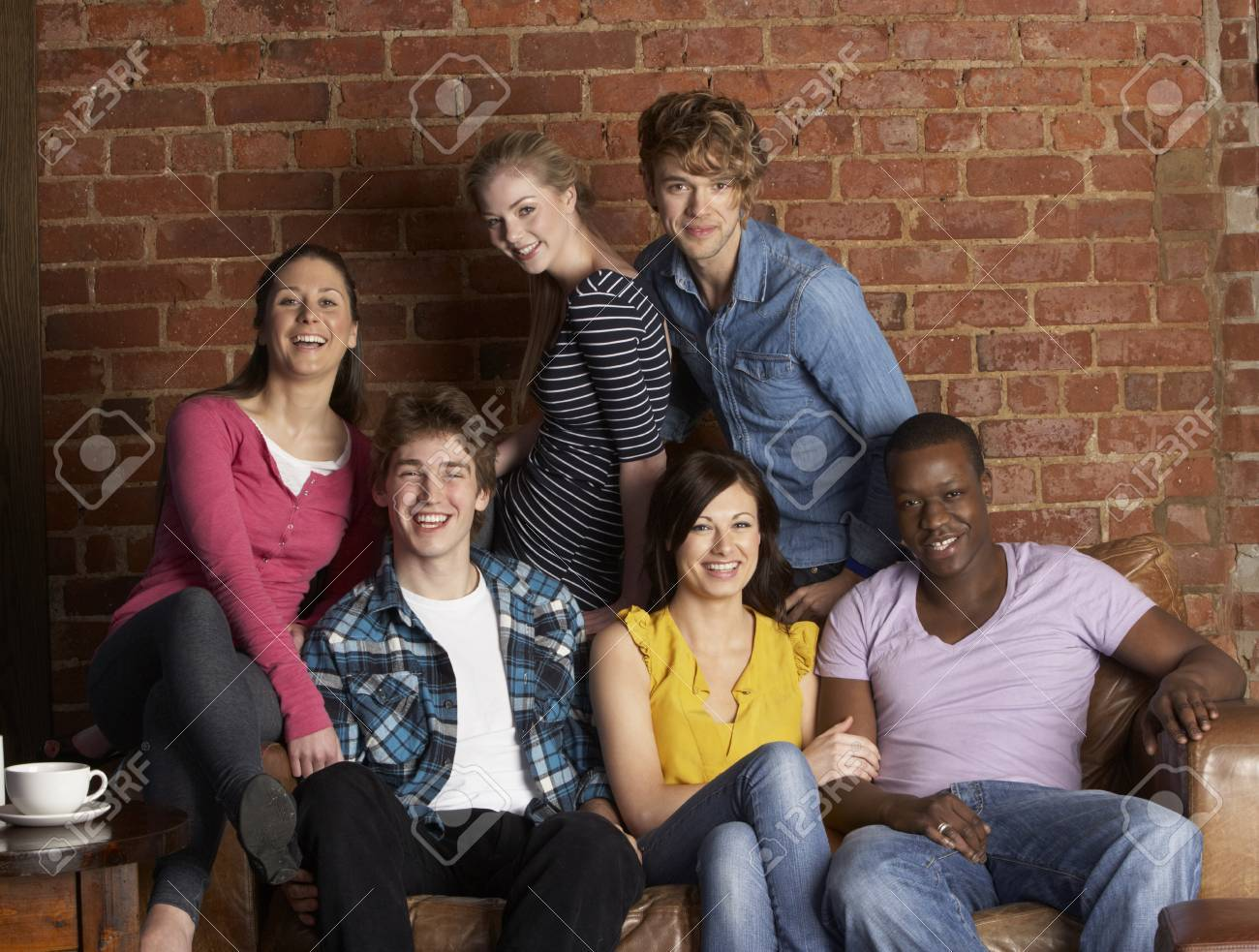 Young friends in café Stock Photo - 10355529