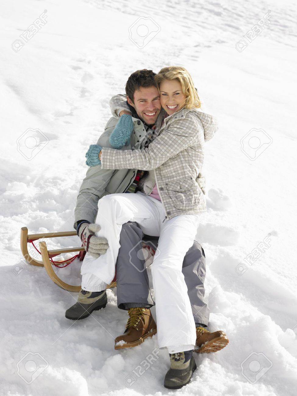 Young Couple On A Sled Stock Photo - 11246633