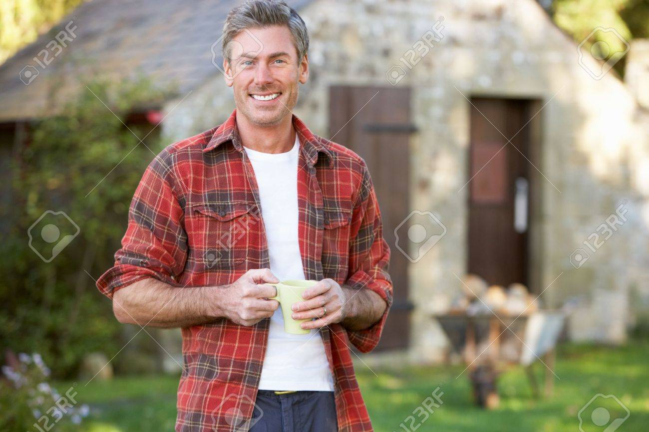 Man in country garden Stock Photo - 11246662