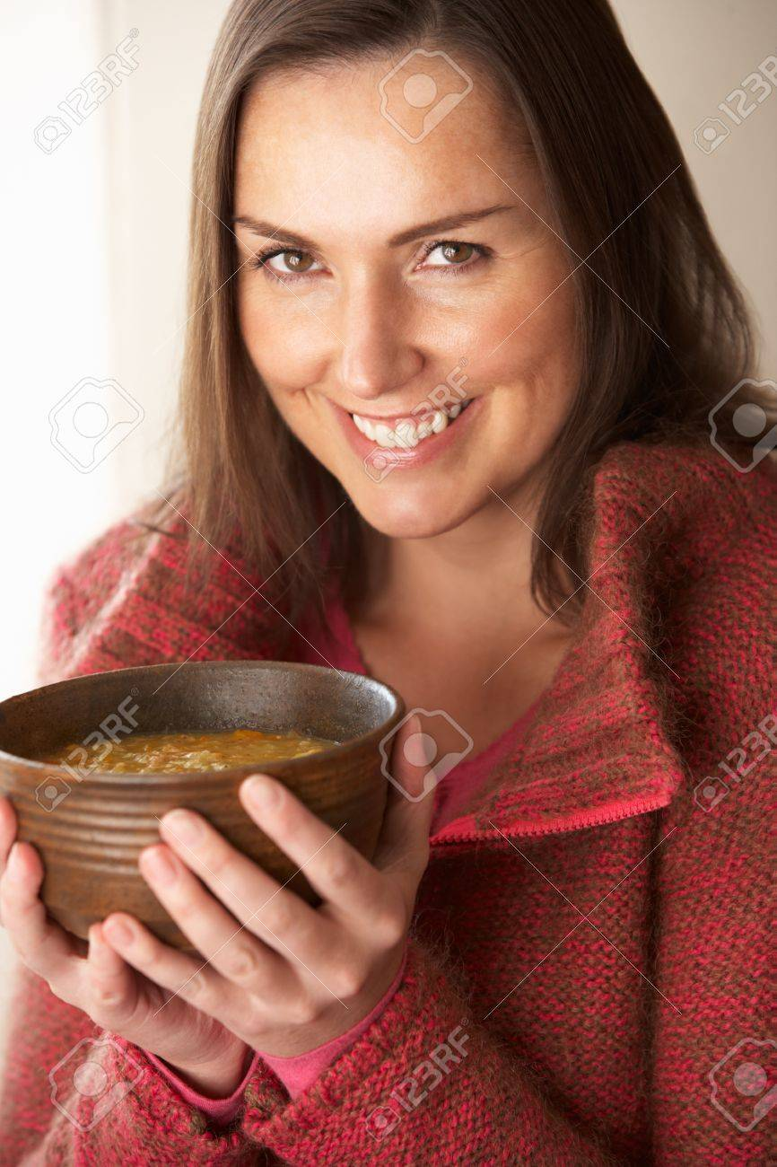 Woman holding bowl of soup Stock Photo - 11246645