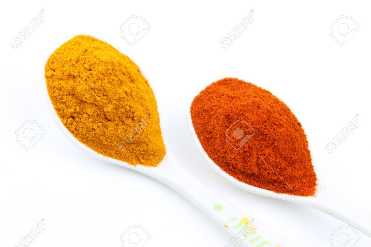 Spoons of turmeric and red chili powder Stock Photo - 6124365