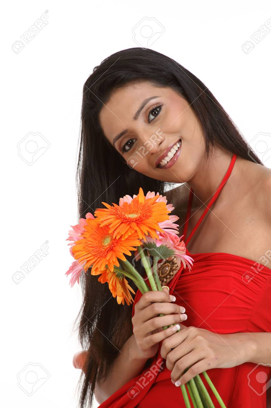 teenage girl sitting with orange and pink daisy flowers Stock Photo - 6148904