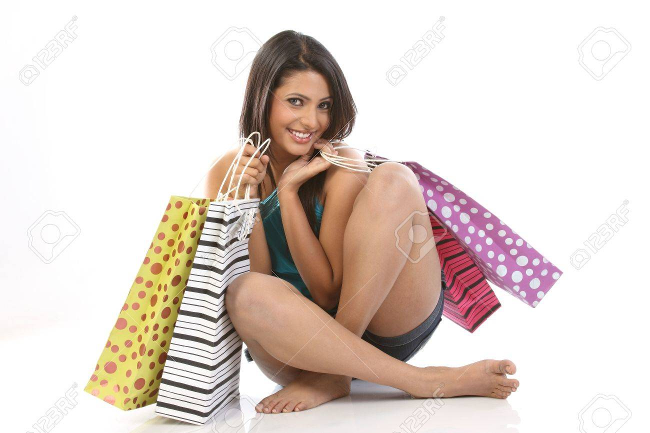 teenage girl seeing all her shopping bags happily Stock Photo - 6600836