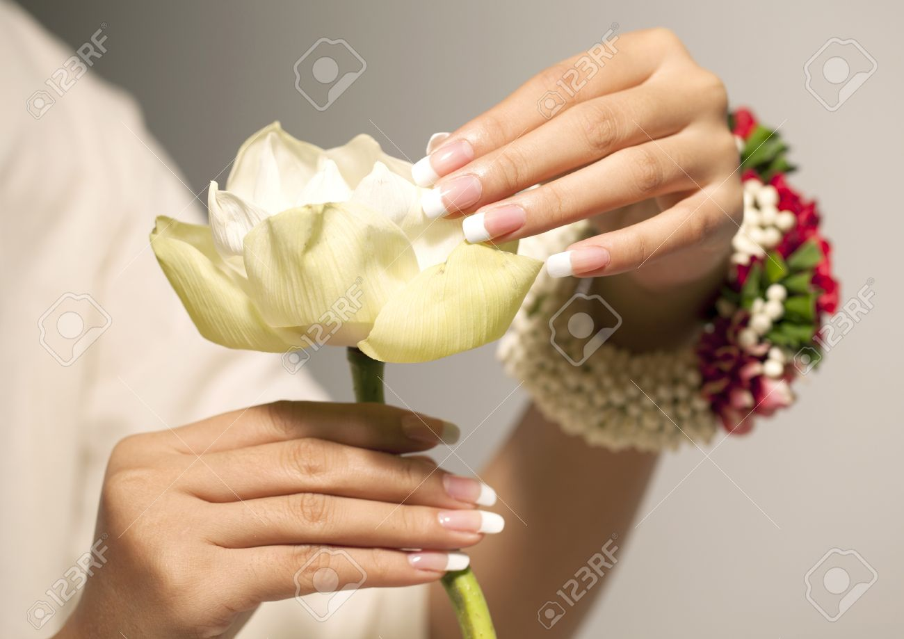 White Lotus Flower, Nice Hands With Nail Art Stock Photo, Picture ...