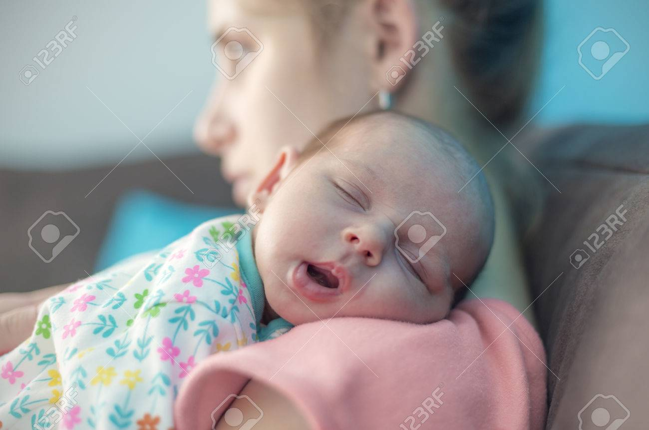 Tired Mother Suffering From Post Natal Depression - 50351705