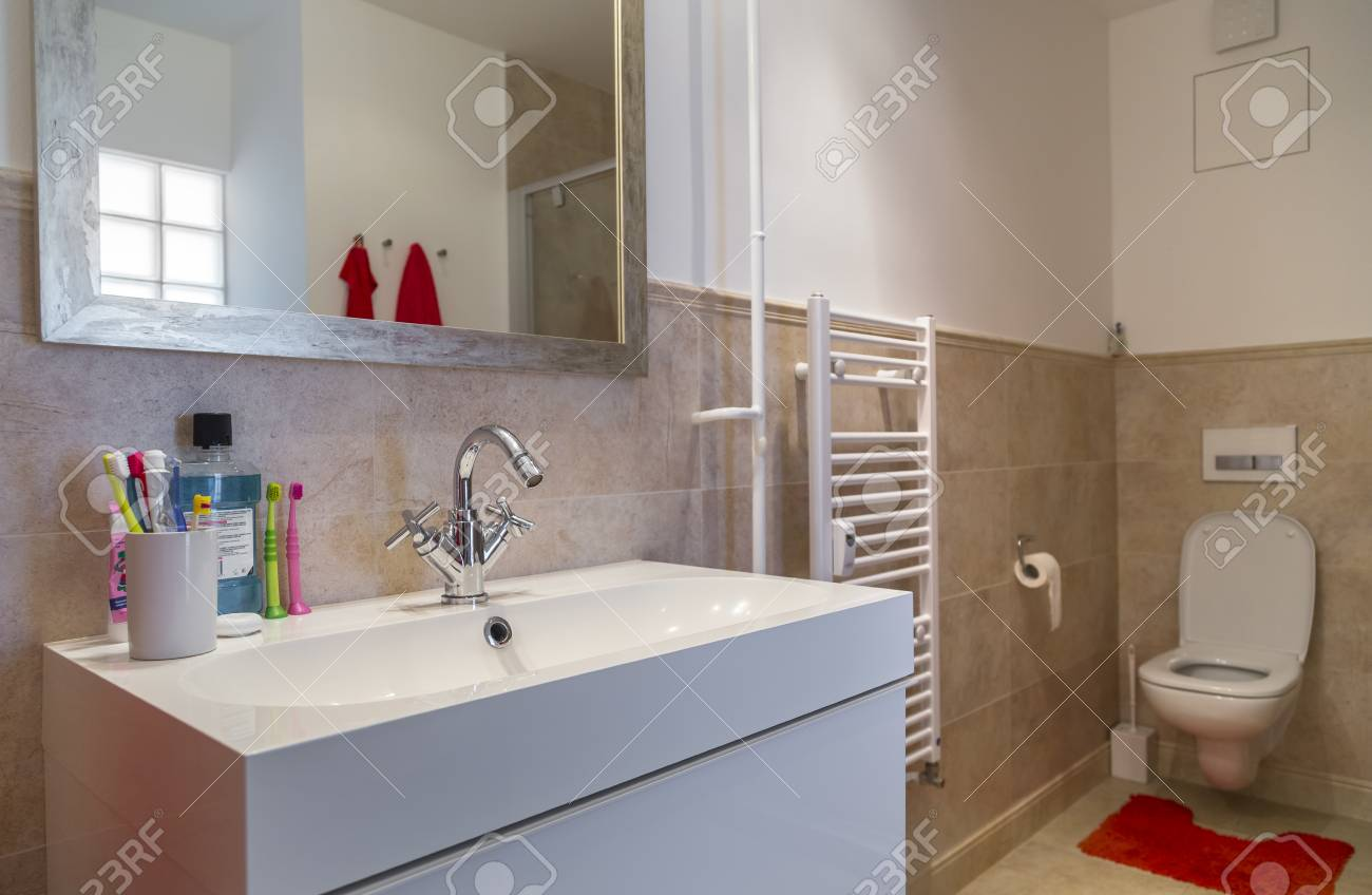 Nice Bathroom In A Two Room Apartment With A Toilet Stock Photo - Nice-apartment-bathrooms