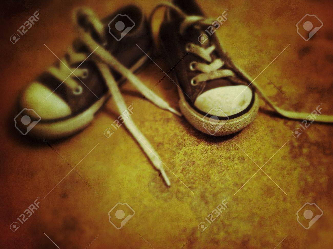 07e4716c04db Stock Photo - Worn out converse all stars
