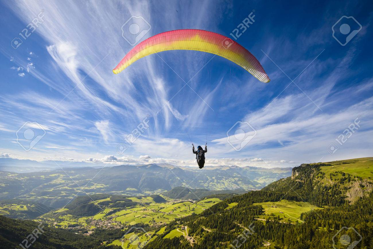 Paraglider flying over mountains in summer day - 32790686