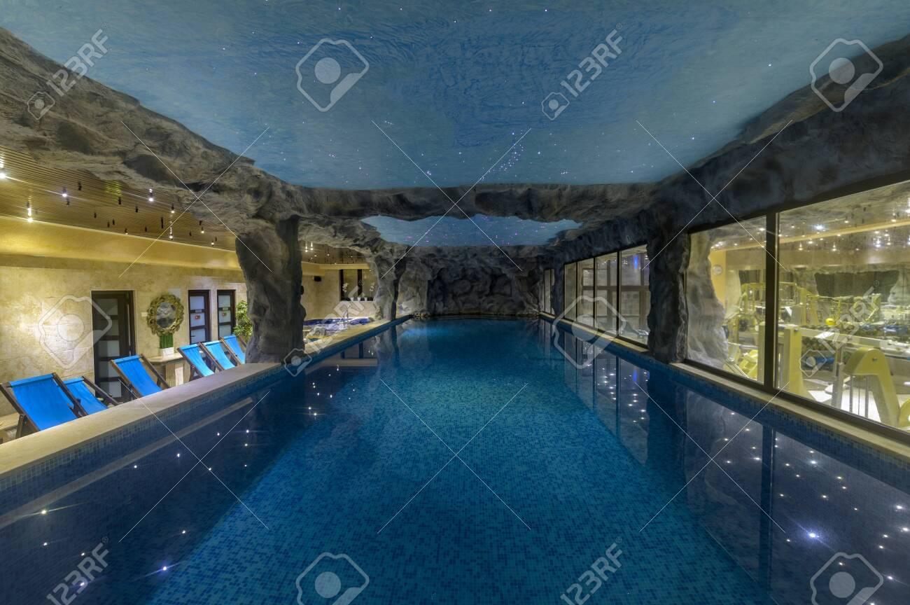 Luxury indoor swimming pool in modern hotel spa