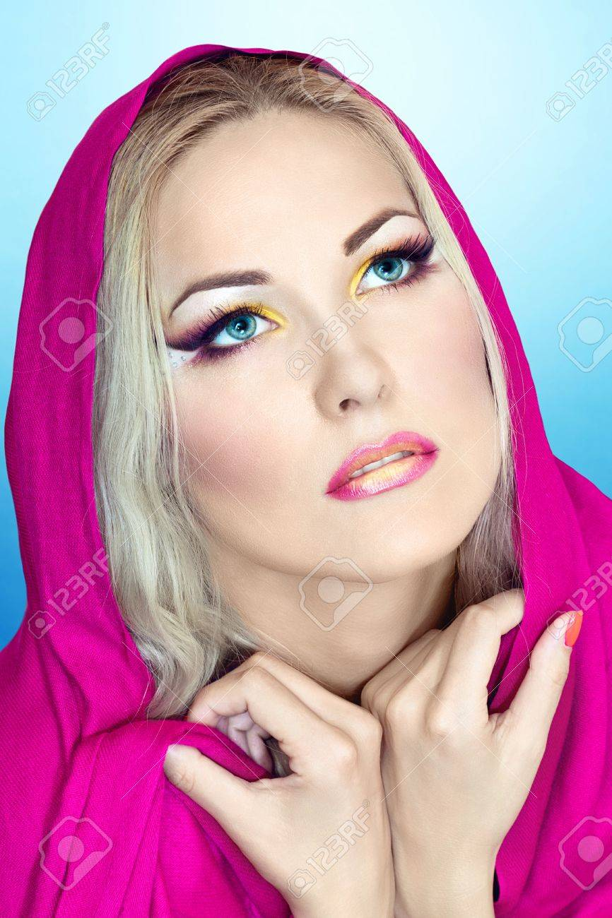 Pretty girl with colorful makeup looking up Stock Photo - 18290850