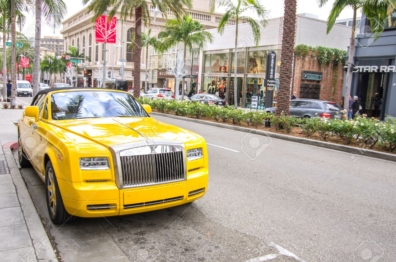 beverly hills,ca - december 18, 2013 yellow rolls royce at rodeo