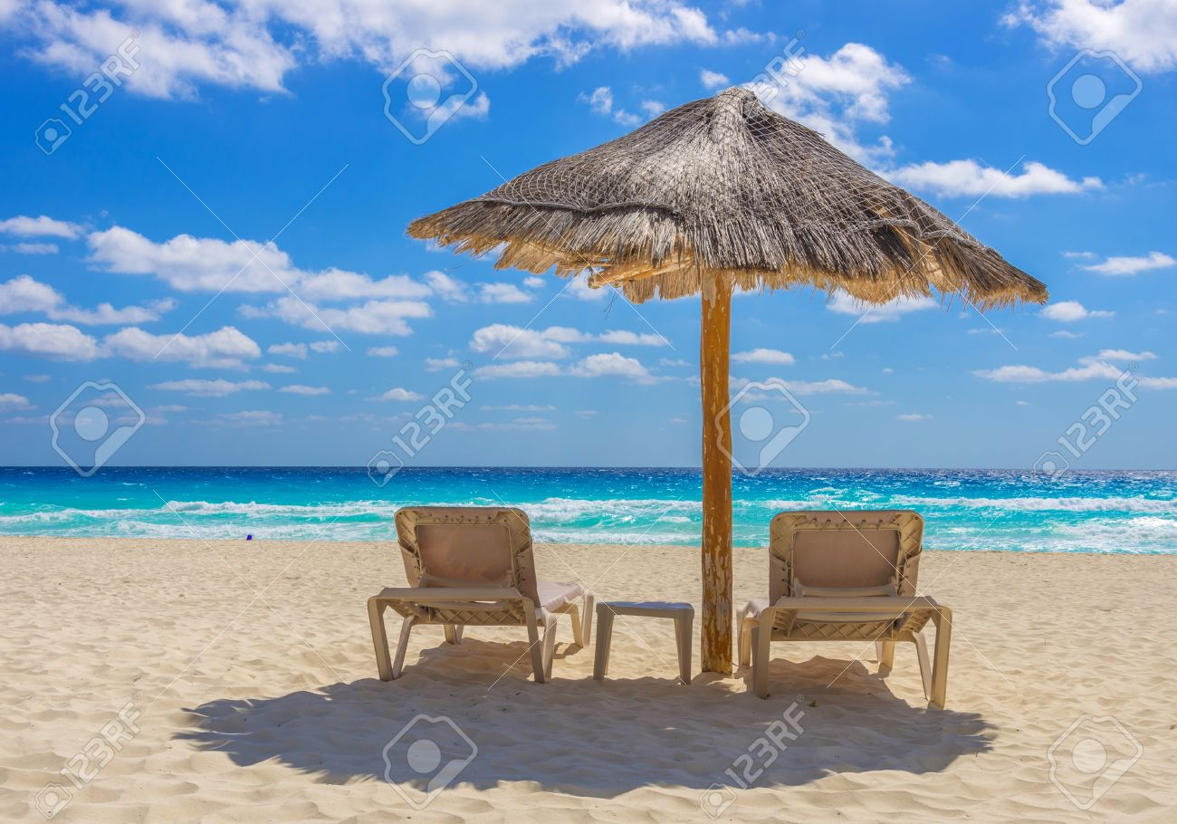 Beach chair with umbrella - Beach Chairs And Umbrella On A Beautiful Tropical Island Stock Photo 27115285