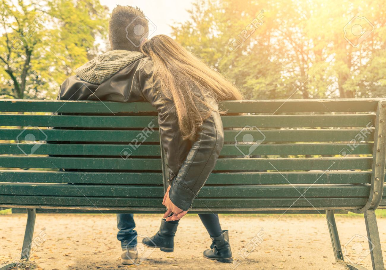 Couple On A Bench Two Lovers Sitting On A Bench In A Park And