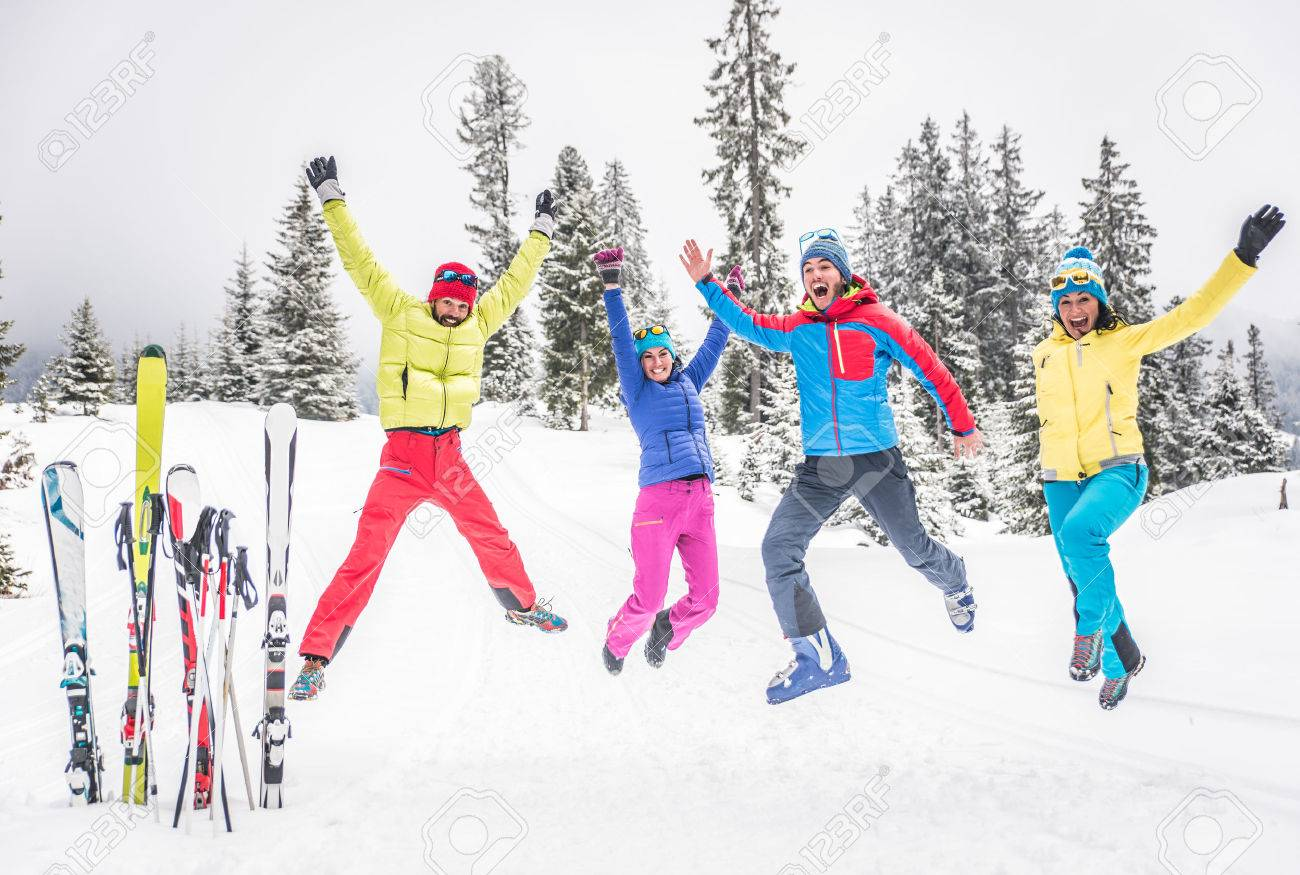 Group of skiers jumping and having fun - 48131732