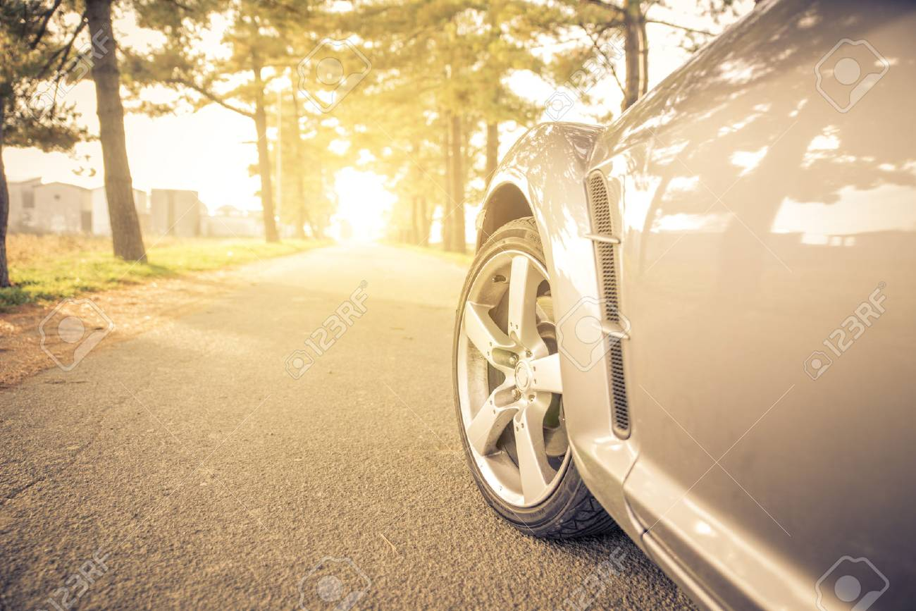 Close Up On A Car Tyre While Drifting On A Street Sport Car Stock