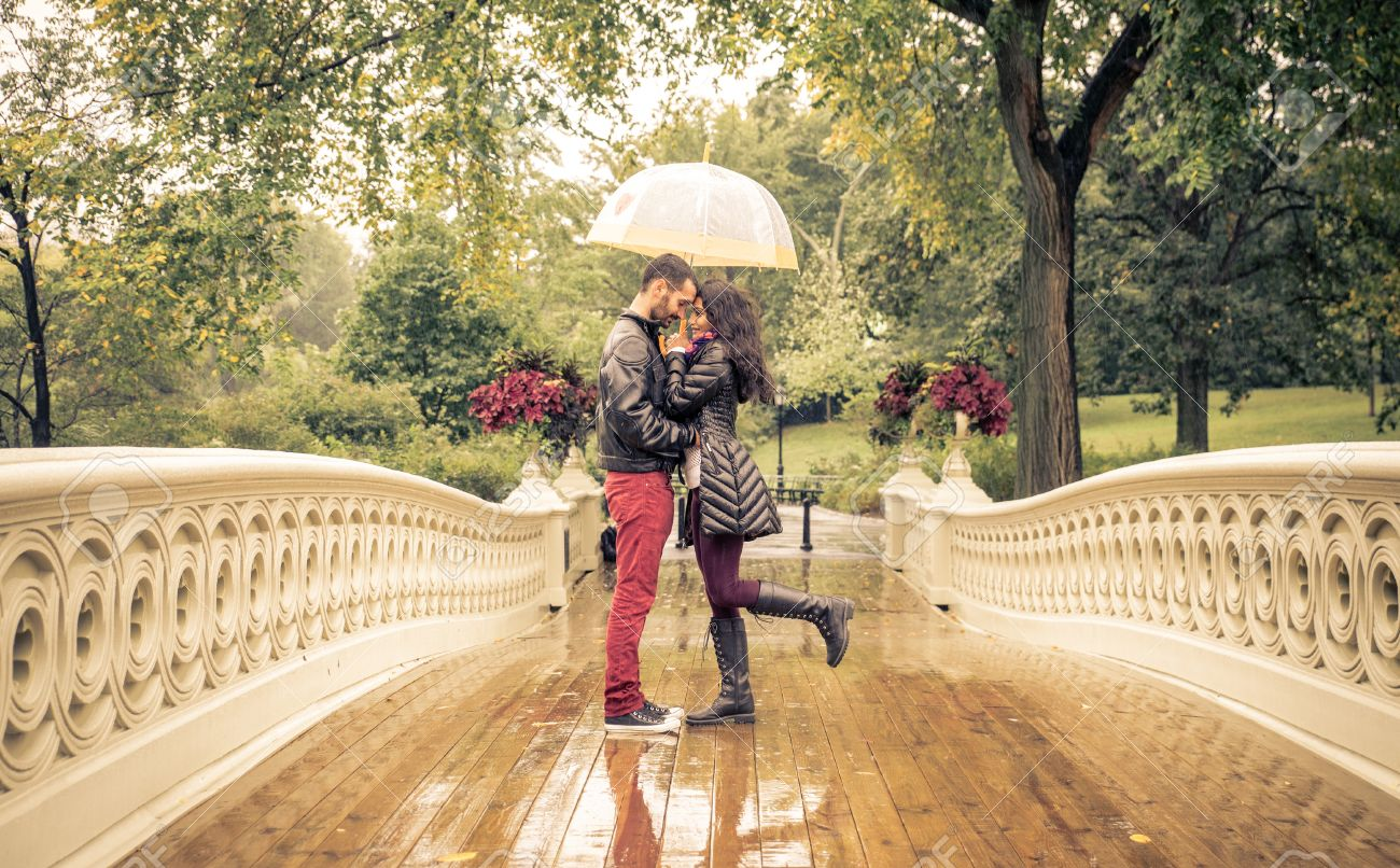 Lovely couple in Central park, New york under the rain Stock Photo - 49082555