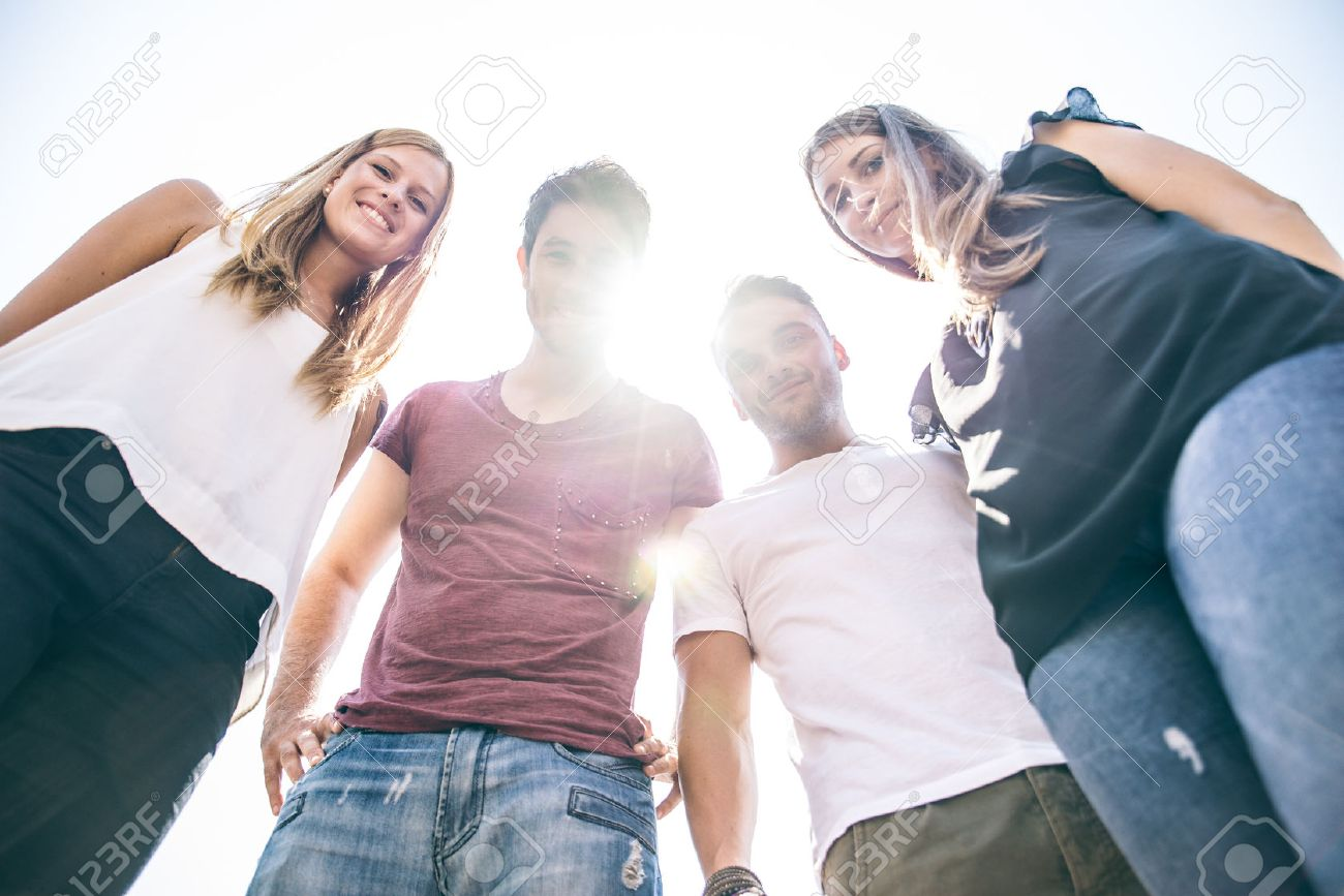 Four Young People Looking Down At Camera With Backlight And Sunflare Stock Photo Picture And Royalty Free Image Image 50576212