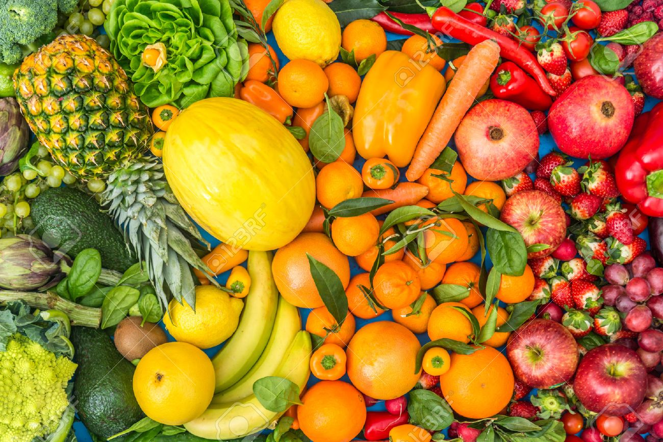 Colorful mix of fruits and vegetables background - Assortment of fresh and natural food sorted by color - 52721537