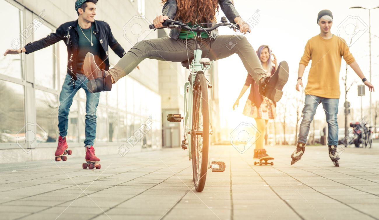 Group of active teenagers in town. four teens making recreational activity in an urban area - 54080797