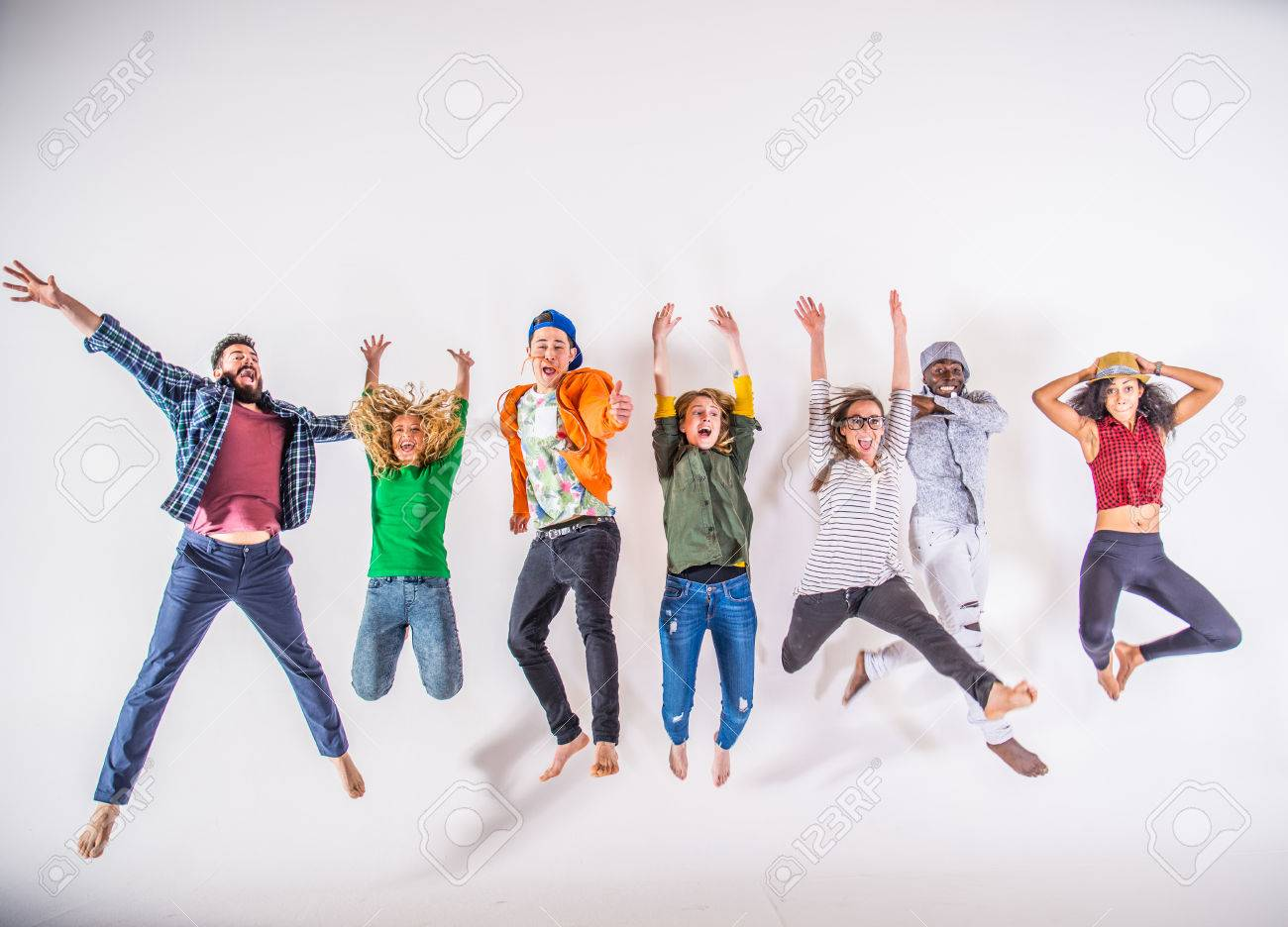 Multi-ethnic group of friends jumping on white background, studio shot - 57813167