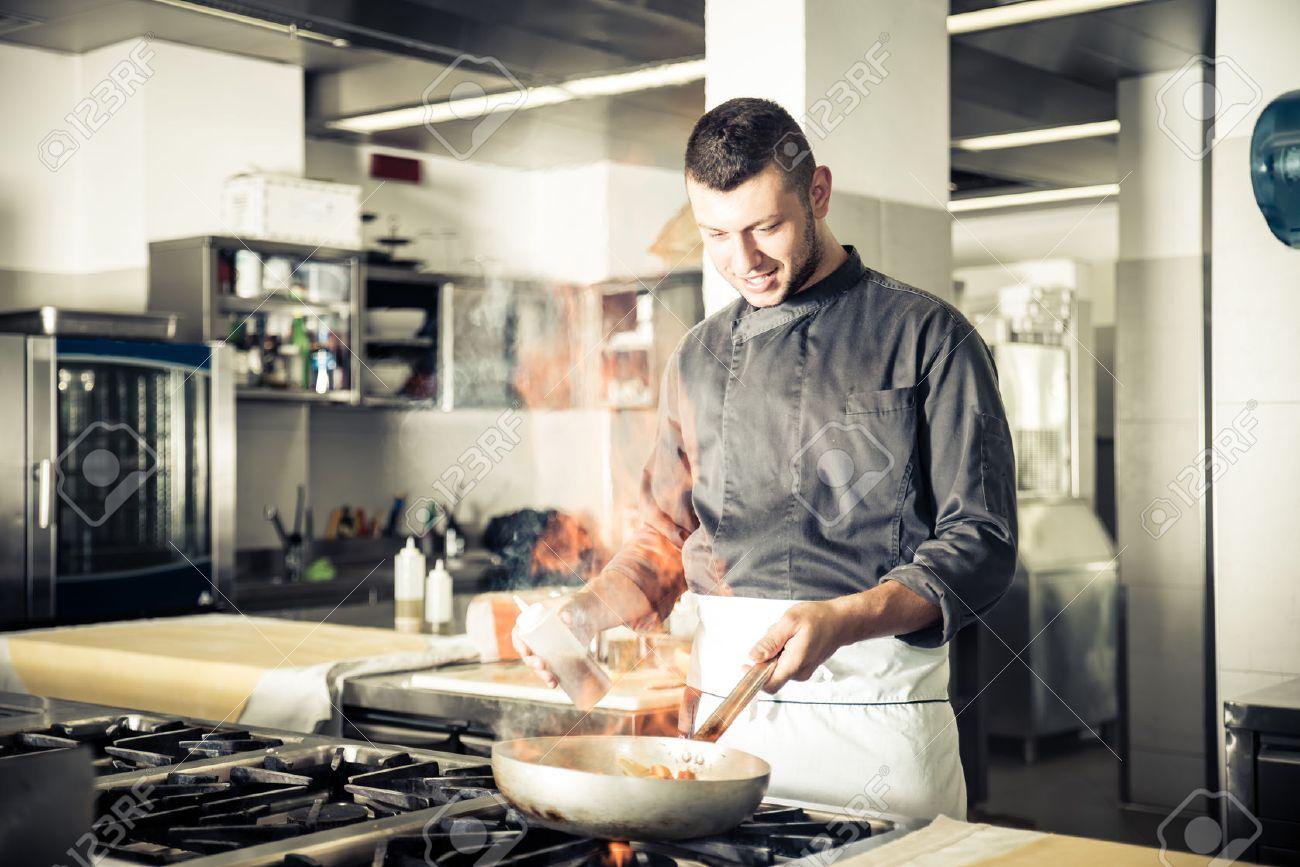 Charmant Chef In Hotel Or Restaurant Kitchen Working And Cooking   Chef In  Restaurant Kitchen At Stove