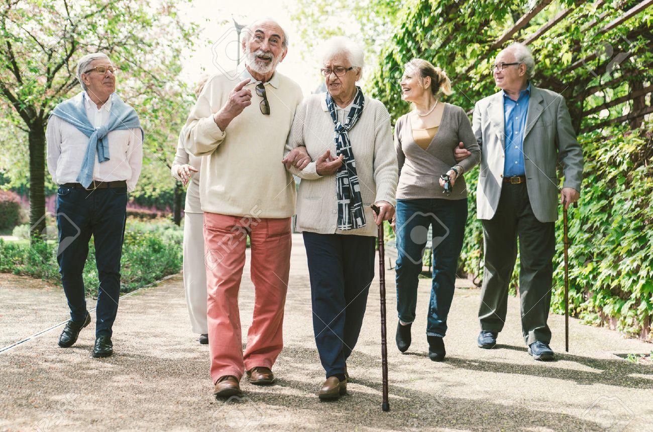 Group of old people walking outdoor - 59039135