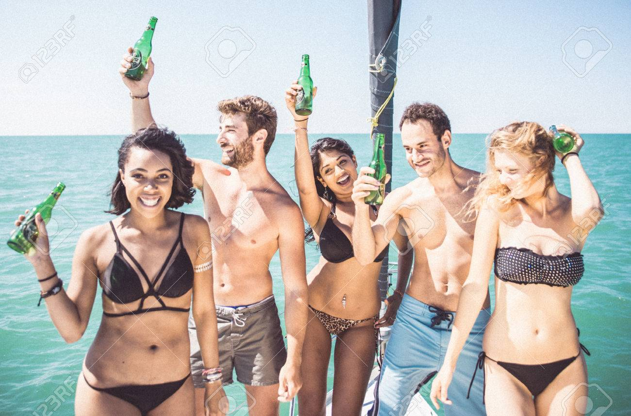 Friends making party on the boat - 65089529
