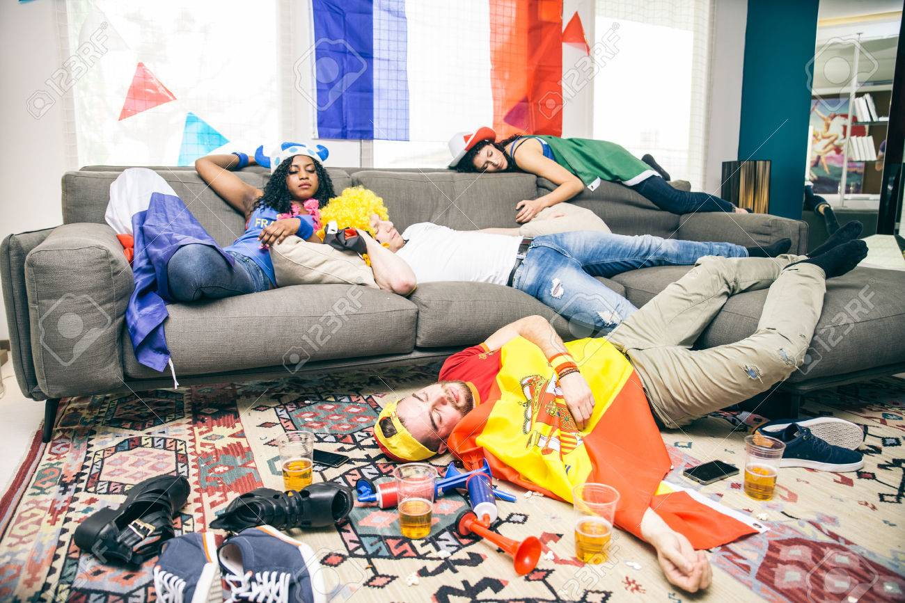 Group of friends sleeping in a living room after party - Drunk..